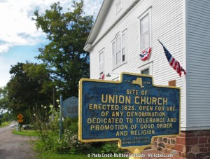 Sign and old church
